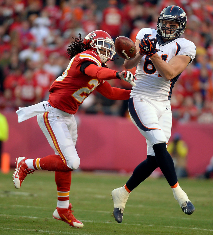 . Kansas City Chiefs free safety Kendrick Lewis (23) knocks the ball away from Denver Broncos tight end Joel Dreessen (81) during the first quarter December 1, 2013 at Arrowhead Stadium.  (Photo by John Leyba/The Denver Post)