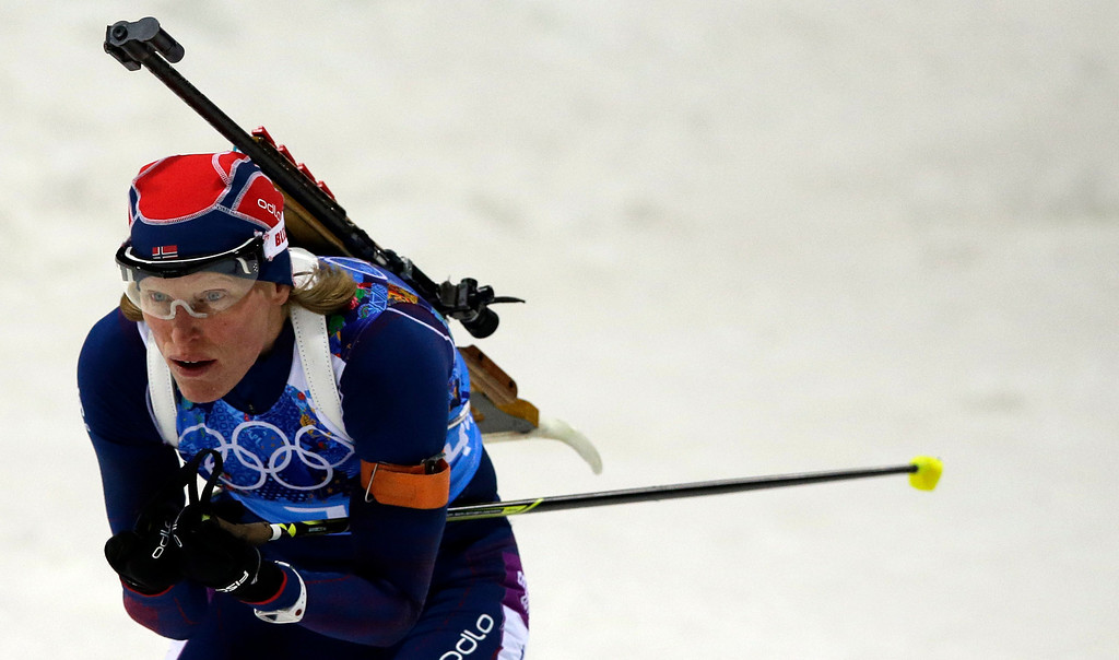 . Norway\'s Tora Berger competes during the women\'s biathlon 4x6k relay at the 2014 Winter Olympics, Friday, Feb. 21, 2014, in Krasnaya Polyana, Russia. (AP Photo/Lee Jin-man)