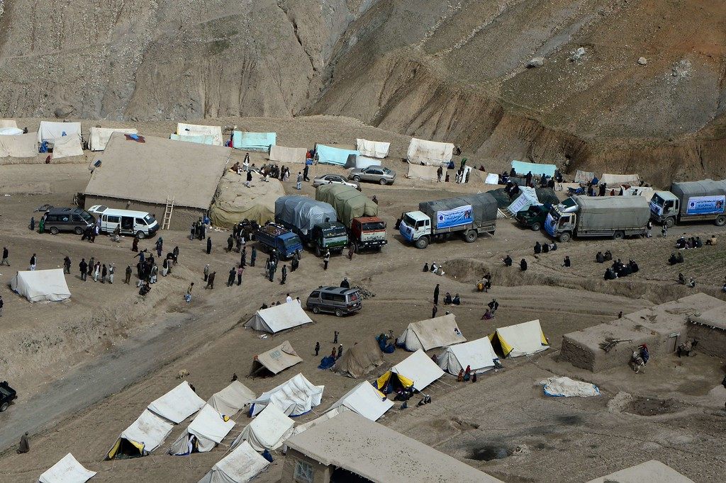 . Afghan landslide-affected villagers gather near tents during aid distribution in Aab Bareek village at Argo district of Badakhshan on May 5, 2014. Afghan officials said they plan to build new houses for hundreds of families made homeless by a landslide that entombed a northeastern village and killed at least 300 people.  AFP PHOTO/WAKIL  KOHSAR/AFP/Getty Images