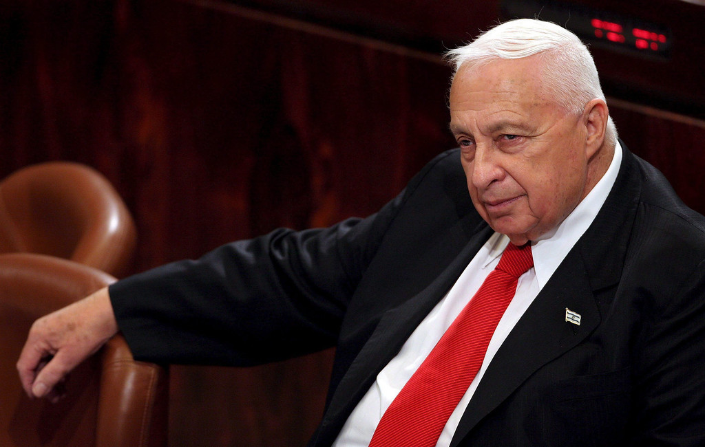 . A file picture dated 28 March 2005 shows then Israeli Prime Minister Ariel Sharon in the Knesset listening to the final speakers on a debate on a bill whether to hold a national referendum on his controversial \'disengagement plan\', in Jerusalem, Israel.  EPA/JIM HOLLANDER