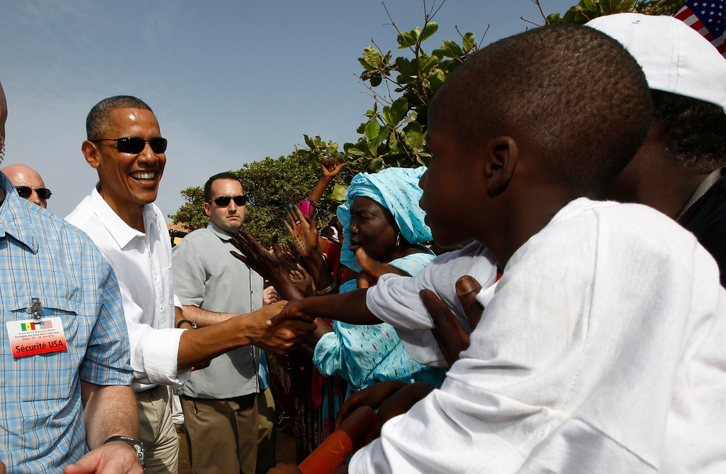 . U.S. President Barack Obama greets well-wishers during his visit to Goree Island near Dakar, Senegal, June 27, 2013. Obama visited the island on Thursday where African slaves in past centuries were shipped west. REUTERS/Jason Reed