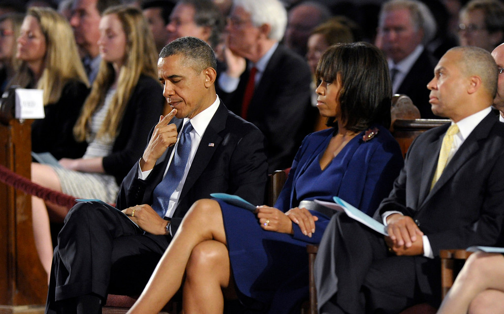 . President Barack Obama, first lady Michelle Obama and Massachusetts Gov. Deval Patick attend an interfaith healing service at the Cathedral of the Holy Cross in Boston, Thursday, April 18, 2013, for victims of Monday\'s Boston Marathon explosions. (AP Photo/Susan Walsh)