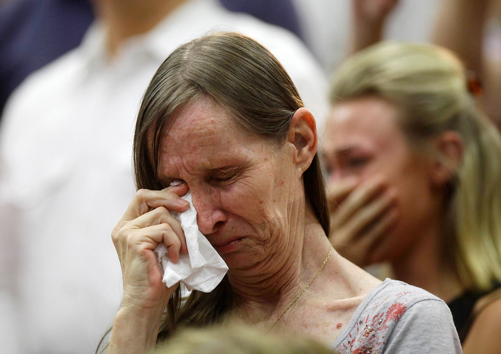 . A woman weeps during a memorial service for the 19 firefighters who perished battling a fast-moving wildfire, in Prescott, Arizona July 1, 2013. An elite squad of 19 Arizona firemen killed in the worst U.S. wildland firefighting tragedy in 80 years apparently was outflanked and engulfed by wind-whipped flames in seconds, before some could scramble into cocoon-like personal shelters. REUTERS/Joshua Lott