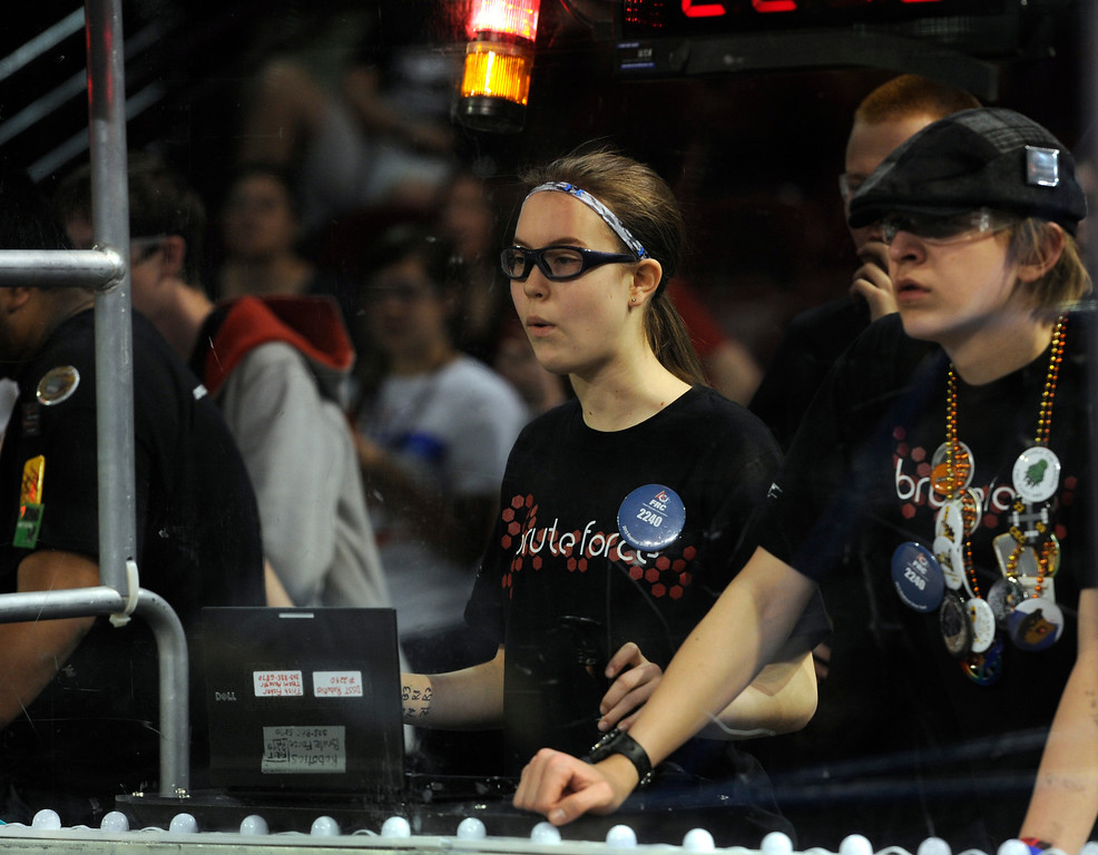 """. DENVER, CO.- APRIL 6: Allison Fisher, 14, left, and Grant Hill, 18, are drivers for the Denver School of Science and Technology, team \""""Brute Force\"""". The Colorado Regional FIRST Robotics Competition takes place in Magness Arena inside the Ritchie Center on the University of Denver campus. High School students from all over the state, region, and even a team from Mexico, participate in a high-tech spectator sporting event (this year the teams used frisbees) using specially engineered robots that are maneuvered by human drivers using computers and joy sticks.(Photo By Kathryn Scott Osler/The Denver Post)"""
