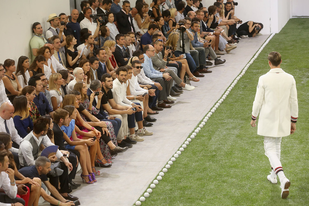 . Guests look on during the Moncler Gamme Bleu show as part of Milan Fashion Week S/S 2014 on June 23, 2013 in Milan, Italy.  (Photo by Victor Boyko/Getty Images for Moncler)