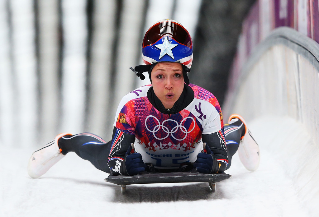 . SOCHI, RUSSIA - FEBRUARY 14:  Katie Uhlaender of the United States finishes a run during the Women\'s Skeleton on Day 7 of the Sochi 2014 Winter Olympics at Sliding Center Sanki on February 14, 2014 in Sochi, Russia.  (Photo by Julian Finney/Getty Images)