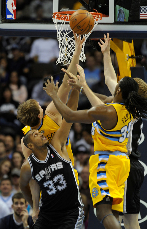 . Spurs center Boris Diaw (33) battled for a rebound in the first half. The Denver Nuggets defeated the San Antonio Spurs 112-106 at the Pepsi Center Tuesday night, December 18, 2012. Karl Gehring/The Denver Post