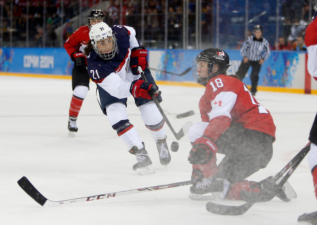 . USA\'s Hilary Knight (21) has her shot blocked by Canada\'s Catherine Ward (18) in the second period for their preliminary round at the Shayba Arena for the 2014 Winter Olympics in Sochi, Russia on Wednesday, Feb. 12, 2014.  (Nhat V. Meyer/Bay Area News Group)