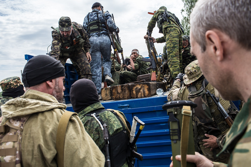. Members of the pro-Russia Vostok Battalion assemble along the side of the road following early morning clashes with pro-Ukraine fighters on May 23, 2014 in Pisky, Ukraine. A (Photo by Brendan Hoffman/Getty Images)