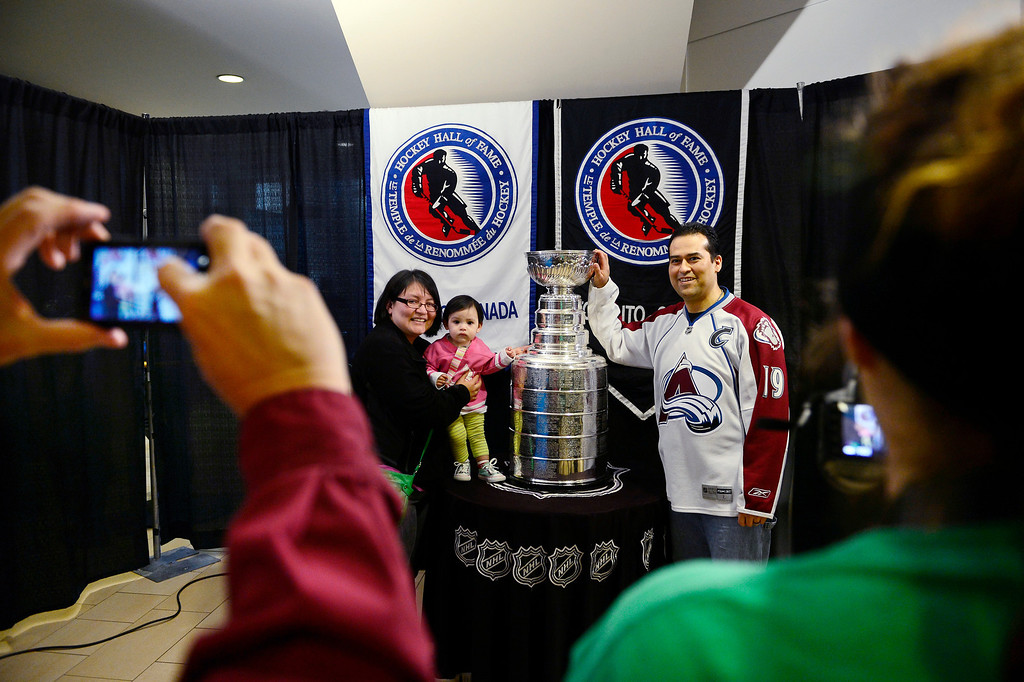 . DENVER, CO - MARCH 24: Francisco and Sandra Llanas pose with their baby Lucia in front of the Stanley Cup before the first period of action. Colorado Avalanche versus the Vancouver Canucks at the Pepsi Center. (Photo by AAron Ontiveroz/The Denver Post)