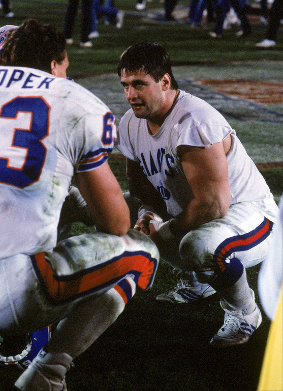 . Defensive tackle Jim Burt of the New York Giants talks with Denver Broncos tackle Mark Cooper after the Giants won Super Bowl XXI at the Rose Bowl on January 25, 1987 in Pasadena, California.    (Photo by George Rose/Getty Images)