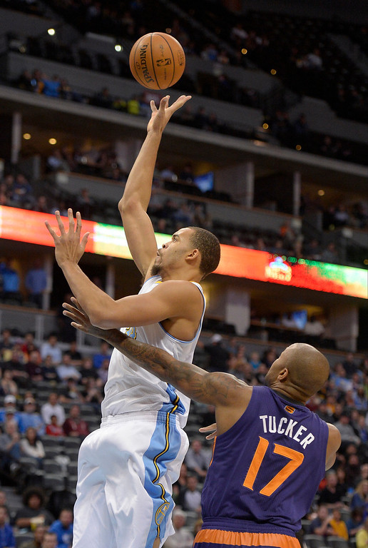 . Denver Nuggets center JaVale McGee (34) takes a shot past Phoenix Suns shooting guard P.J. Tucker (17) during the first quarter October 23, 2013 at Pepsi Center. (Photo By John Leyba/The Denver Post)