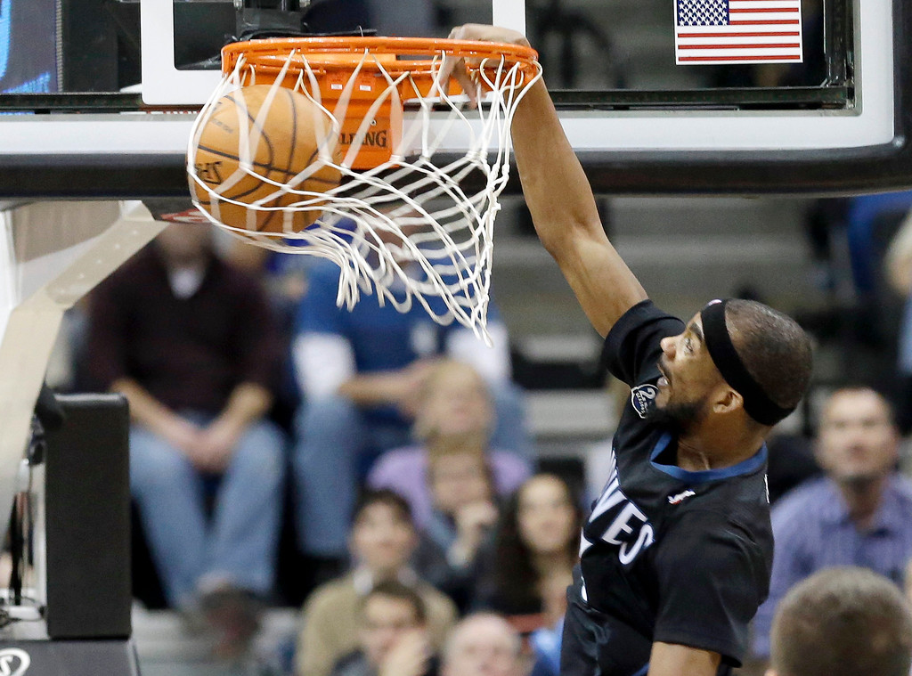 . Minnesota Timberwolves\' Corey Brewer dunks in the second half of an NBA basketball game against the Denver Nuggets, Wednesday, Nov. 27, 2013, in Minneapolis. The Nuggets won 117-110. (AP Photo/Jim Mone)