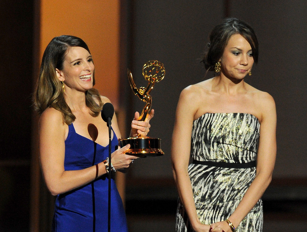 . Winners for Best Writing for a Comedy Series Tina Fey and Tracey Wigfield speak onstage during the 65th Annual Primetime Emmy Awards held at Nokia Theatre L.A. Live on September 22, 2013 in Los Angeles, California.  (Photo by Kevin Winter/Getty Images)