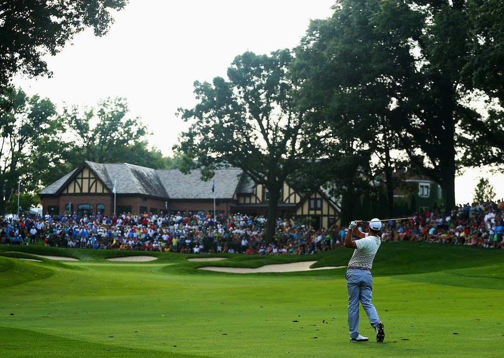 . ROCHESTER, NY - AUGUST 08:  Adam Scott of Australia hits a shot on the 13th hole during the first round of the 95th PGA Championship on August 8, 2013 in Rochester, New York.  (Photo by Streeter Lecka/Getty Images)