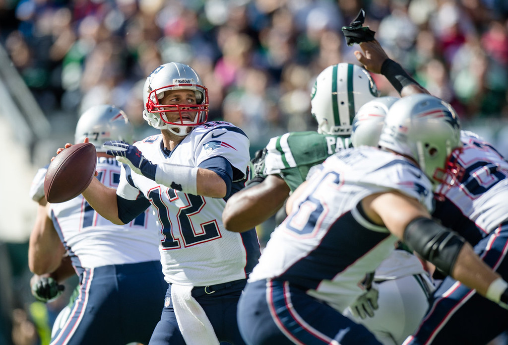 . Quarterback Tom Brady #12 of the New England Patriots throws a pass in the 1st quarter against the New York Jets at MetLife Stadium on October 20, 2013 in East Rutherford, New Jersey. (Photo by Ron Antonelli/Getty Images)