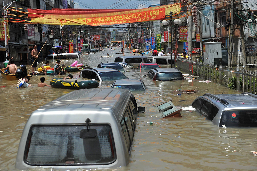 . Vehicles submerged by water in the flood-hit Chaonan district of Shantou, in southern China\'s Guangdong province on on August 19, 2013.  Devastating floods at opposite ends of China have left 105 people dead and another 115 missing in recent days, state media said on August 19.   AFP PHOTOSTR/AFP/Getty Images