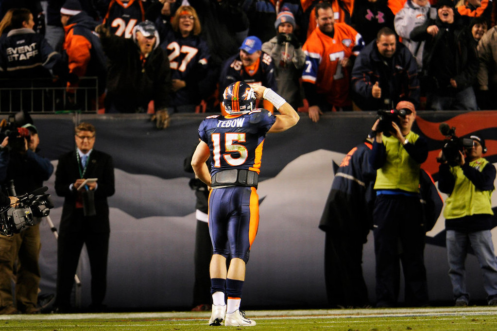. Denver Broncos quarterback Tim Tebow (15) goes back to the fans to deliver the Mile High Salute after scoring the winning touchdown to put them up 17-13 over the New York Jets Thursday night at Sports Authority Field at Mile High. 11/17/11. Photo by Joe Amon, The Denver Post.