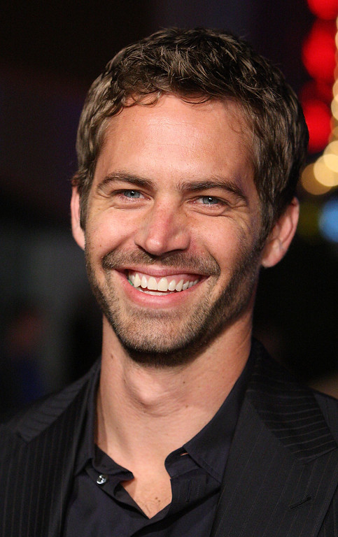 """. Actor Paul Walker arrives at the premiere Universal\'s \""""Fast & Furious\"""" held at  Universal CityWalk Theaters on March 12, 2009 in Universal City, California.  (Photo by Jason Merritt/Getty Images)"""