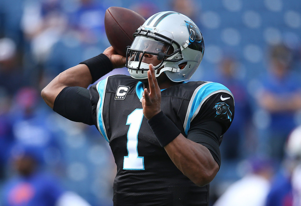 . Cam Newton #1 of the Carolina Panthers warms up before NFL game action against the Buffalo Bills at Ralph Wilson Stadium on September 15, 2013 in Orchard Park, New York. (Photo by Tom Szczerbowski/Getty Images)