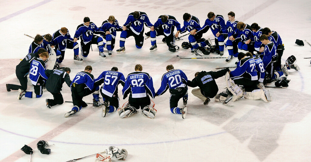 . DENVER, CO. - FEBRUARY 28: The Cougars bowed their heads in prayer at center ice following the loss Thursday night. Ralston Valley High School defeated Resurrection Christian 5-1 Thursday night, February 28, 2013 in a semifinal match in the Colorado State Ice Hockey Championships at Magness Arena in Denver. The Mustangs advanced to play in the title game Friday night. (Photo By Karl Gehring/The Denver Post)
