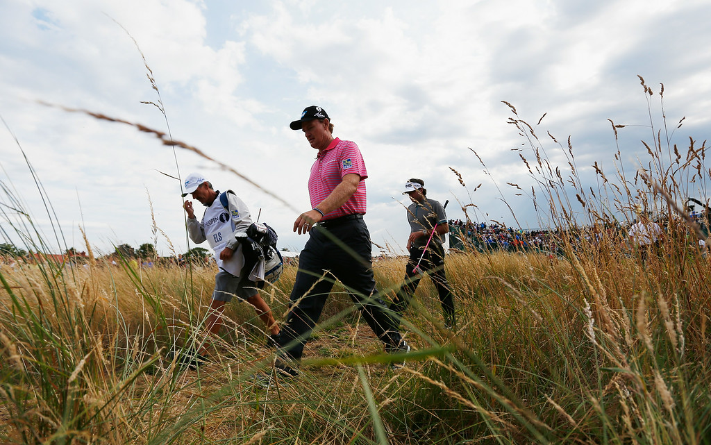 . HOYLAKE, ENGLAND - JULY 18:  Ernie Els of South Africa walks with Bubba Watson of the United States during the second round of The 143rd Open Championship at Royal Liverpool on July 18, 2014 in Hoylake, England.  (Photo by Tom Pennington/Getty Images)