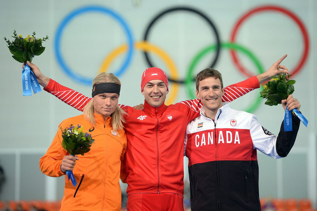 . (L-R) Netherlands\' silver medalist Koen Verweij, Poland\'s gold medalist Zbigniew Brodka and Canada\'s bronze medalist Denny Morrison pose on the podium during the Men\'s Speed Skating 1500 m Flower Ceremony at the Adler Arena during the Sochi Winter Olympics on February 15, 2014. JUNG YEON-JE/AFP/Getty Images