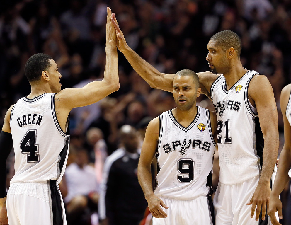 . Danny Green #4, Tony Parker #9 and Tim Duncan #21 of the San Antonio Spurs celebrate in the fourth quarter against the Miami Heat during Game Five of the 2013 NBA Finals at the AT&T Center on June 16, 2013 in San Antonio, Texas.   (Photo by Kevin C. Cox/Getty Images)