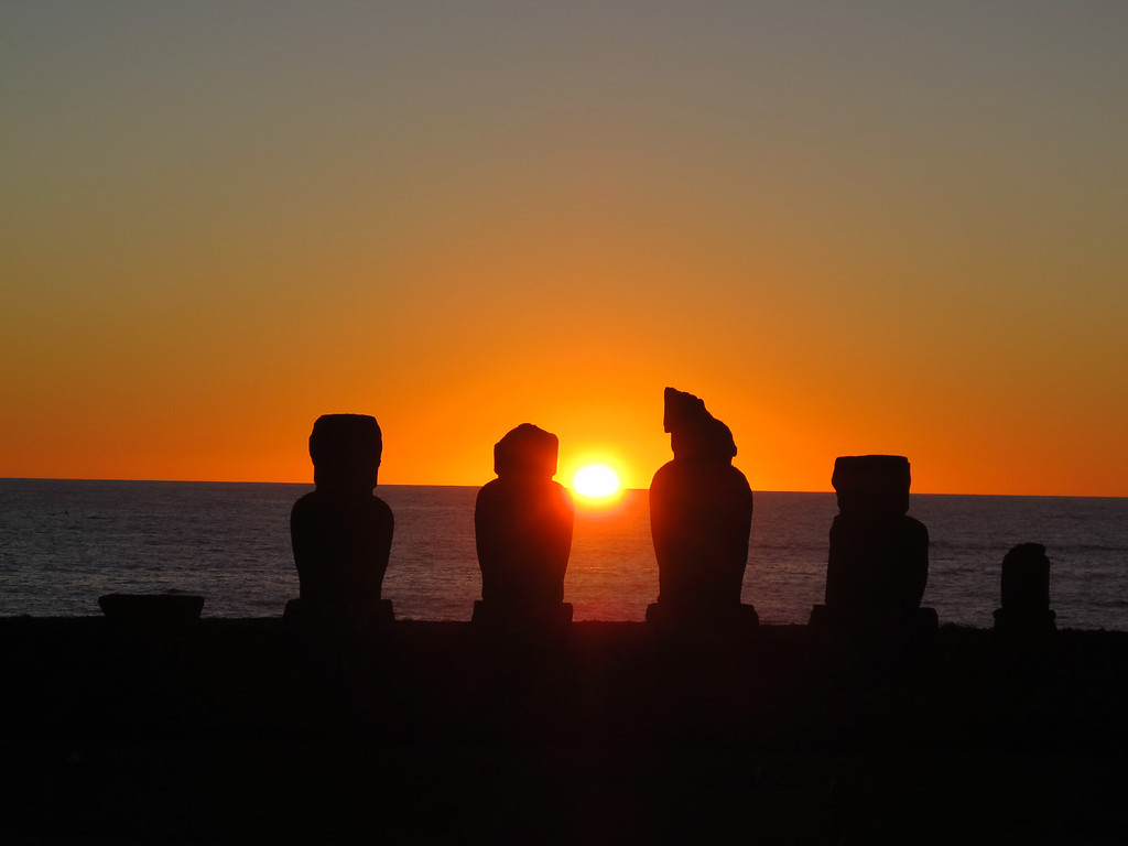 . This August 2012 photo shows the sunset behind the Ahu Vai Uri platform at Tahai on Easter Island. Tahai, within easy walking  distance of the town of Hanga Roa, was restored between 1968 and 1970 and features three different platforms. (AP Photo/Karen Schwartz)