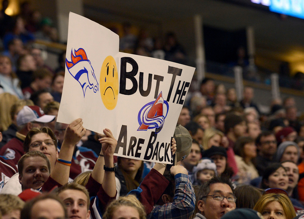 . DENVER, CO. - JANUARY 24: Colorado Avalanche fans hold up signs during the game January 24, 2013 at Pepsi Center. The Colorado Avalanche defeated the  Columbus Blue Jackets 4-0.  (Photo By John Leyba / The Denver Post)