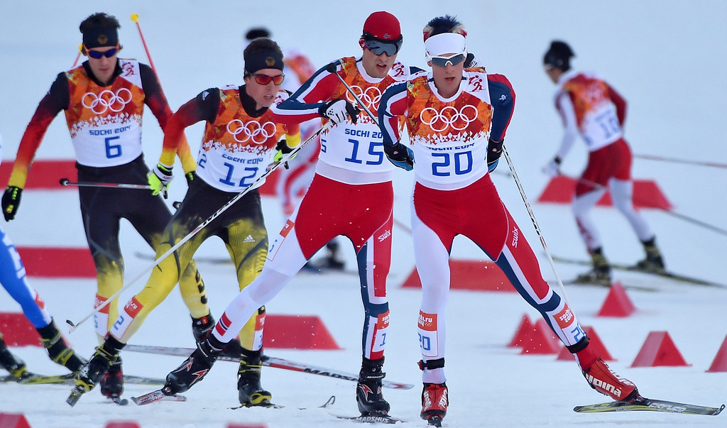 . Bronze medalist Magnus Krog of Norway (R) in action during the 10km Cross Country portion of the Nordic Combined Individual competition at the Russki Gorki Center at the Sochi 2014 Olympic Games, Krasnaya Polyana, Russia, 12 February 2014.  EPA/HENDRIK SCHMIDT