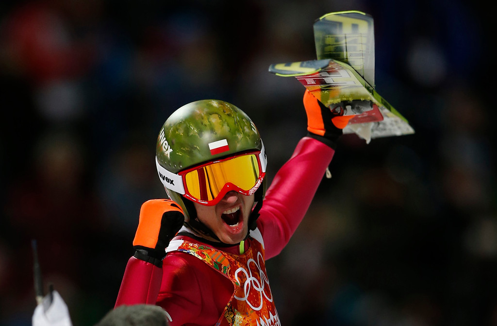 . Poland\'s Kamil Stoch celebrates winning the gold medal after the men\'s normal hill ski jumping final at the 2014 Winter Olympics, Sunday, Feb. 9, 2014, in Krasnaya Polyana, Russia. (AP Photo/Matthias Schrader)