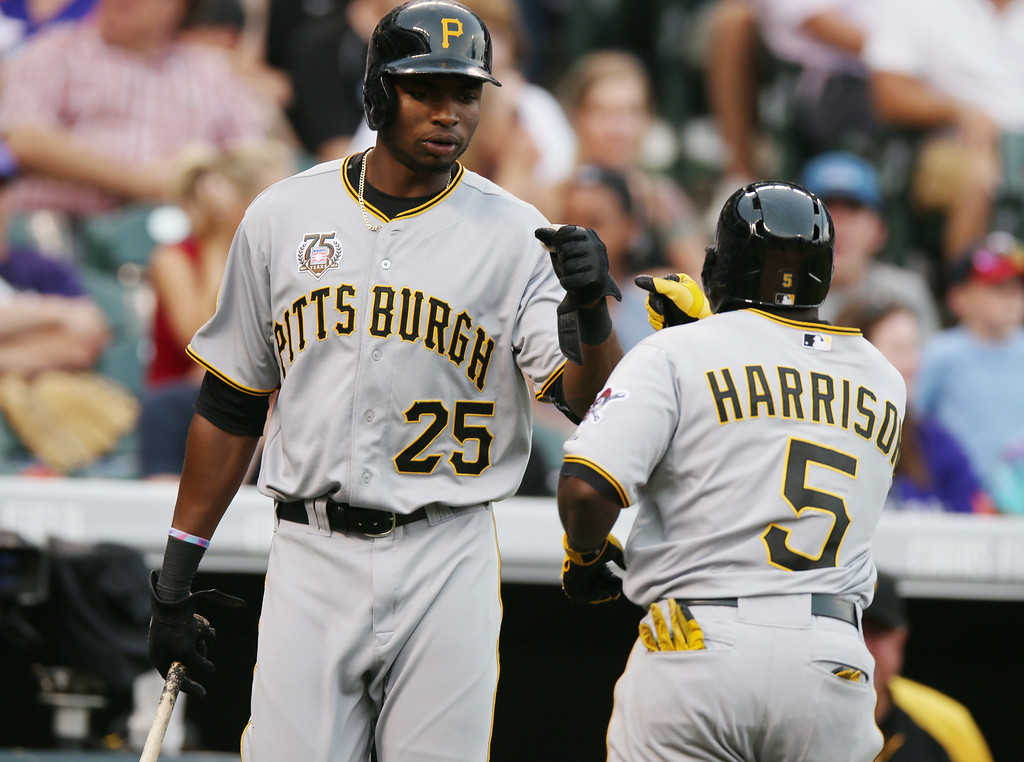 . Pittsburgh Pirates\' Gregory Polanco, left, congratulates teammate Josh Harrison on his solo home run against the Colorado Rockies to lead off the eighth inning of the Pirates\' 7-5 victory in a baseball game in Denver, Sunday, July 27, 2014. (AP Photo/David Zalubowski)