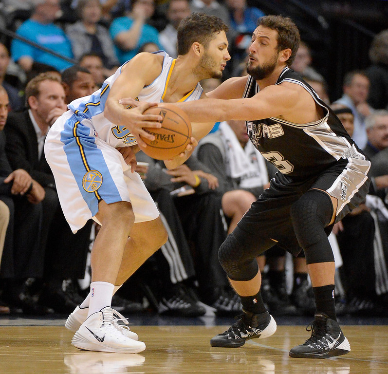 . San Antonio Spurs shooting guard Marco Belinelli (3) reaches in on Denver Nuggets shooting guard Evan Fournier (94) during the first quarter October 14, 2013 at Pepsi Center. (Photo By John Leyba/The Denver Post)