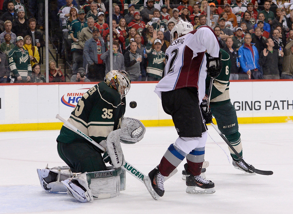 . ,Minnesota Wild goalie Darcy Kuemper (35) makes a save on a deflected shot by Colorado Avalanche left wing Gabriel Landeskog (92) in the final seconds of the third period April 24, 2014 in Game 4 of the Stanley Cup Playoffs at Xcel Energy Center.  (Photo by John Leyba/The Denver Post)