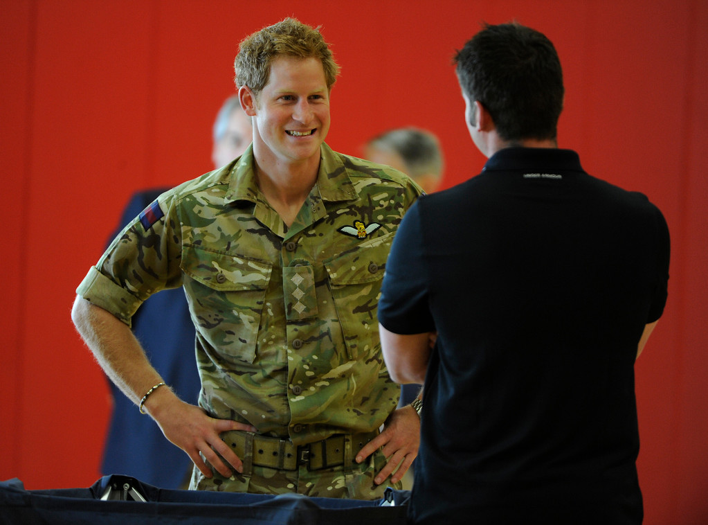 . COLORADO SPRINGS, CO - MAY 11: Britain\'s Prince Harry,  talks with British Armed Forces Army Capt. Dave Hensen, at the United States Olympic Training Center before the 2013 Warrior Games Saturday morning, May 11th, 2013. British Armed Forces team leader/coach, Martin Colclough, left, makes introductions. (Photo By Andy Cross/The Denver Post)