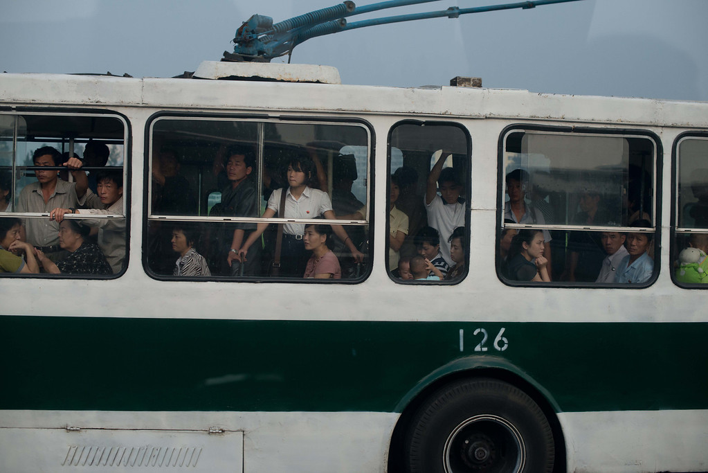 . Commuters ride a bus in Pyongyang on July 25, 2013. North Korea is preparing to mark the 60th anniversary of the end of the Korean War which ran from 1950 to 1953, with a series of performances, festivals, and cultural events culminating with a large military parade taking place on July 27. AFP PHOTO / Ed JonesEd Jones/AFP/Getty Images