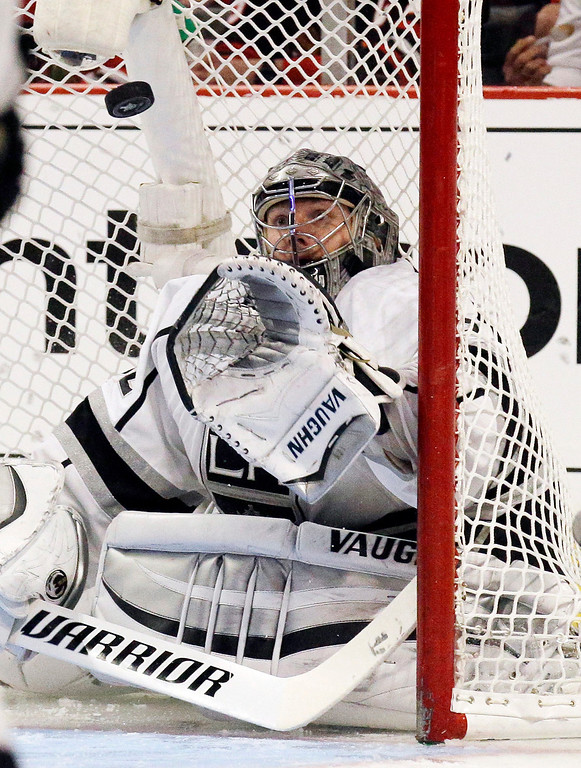 . Los Angeles Kings goalie Jonathan Quick saves a goal shot by Chicago Blackhawks left wing Brandon Saad during the second period in Game 5 of the Western Conference finals in the NHL hockey Stanley Cup playoffs Wednesday, May 28, 2014, in Chicago. (AP Photo/Nam Y. Huh)