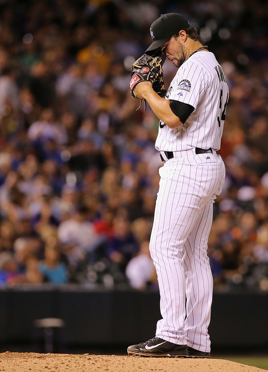 . DENVER, CO - AUGUST 05:  Relief pitcher Tommy Kahnle #54 of the Colorado Rockies reacts on the mound as he works against the Chicago Cubs in the seventh inning at Coors Field on August 5, 2014 in Denver, Colorado.  (Photo by Doug Pensinger/Getty Images)