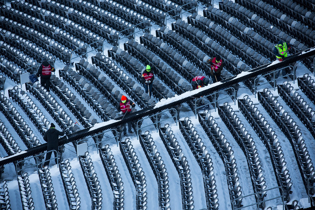 . Crews work to remove snow from MetLife Stadium, which will host Superbowl XLVIII next month, on January 22, 2014 in East Rutherford, New Jersey. (Photo by Andrew Burton/Getty Images)
