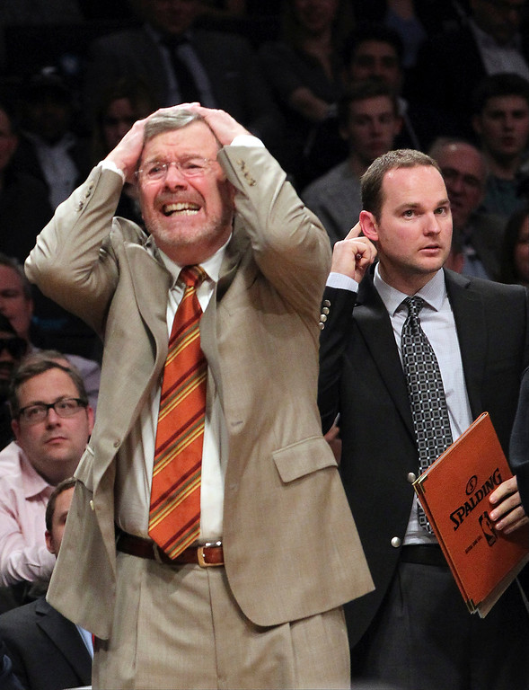 . Brooklyn Nets head coach P.J. Carlesimo, left, reacts near assistant coach Patrick Spurgin, right, during the second half of an NBA basketball game against the Denver Nuggets, Wednesday, Feb. 13, 2013, at Barclays Center in New York. The Nuggets won 119-108. (AP Photo/Mary Altaffer)