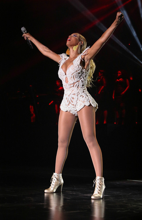 """. Singer Beyonce performs on her \""""Mrs. Carter Show World Tour 2013,\"""" on Tuesday, Sept. 17, 2013 at the Estadio Nacional in Brasilia, Brazil. (Photo by Nick Farrell/Invision for Parkwood Entertainment/AP Images)"""