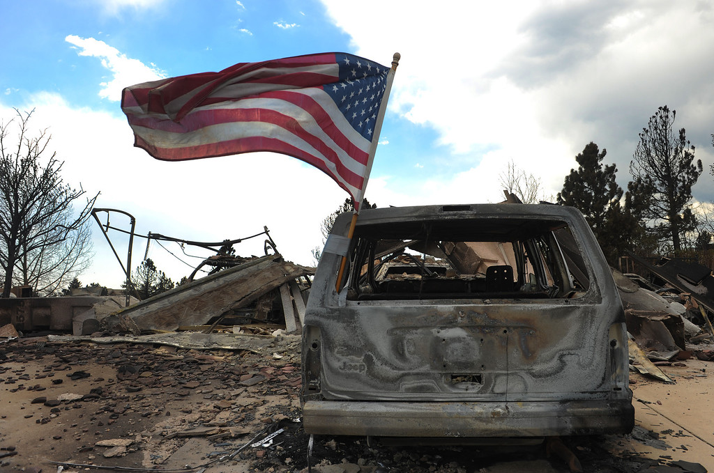 . An American flag flies on the back of a burned out car in the Mountain Shadows subdivision after the Waldo Canyon fire ravaged the neighborhood. Helen H. Richardson, The Denver Post