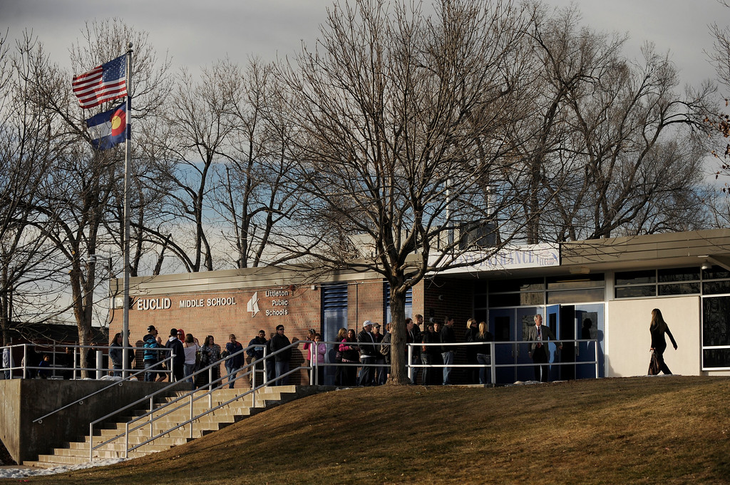 . Parents and guardians of Euclid Middle School students wait in a line to collect their children one-by-one on Dec. 13 after a lone gunman - a senior at Arapahoe High School - entered the high school and fired gunshots, wounding three people and then killing himself. AHS students were transferred to Euclid Middle School after the shooting. Photo by Jamie Cotten, Special to The Denver Post