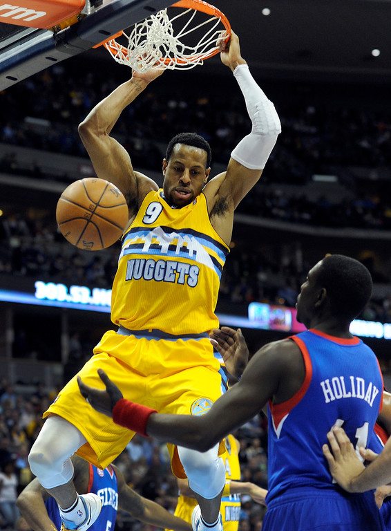 . DENVER, CO. - MARCH 21: Andre Iguodala (9) of the Denver Nuggets slammed the ball through the hoop in the first half. The Denver Nuggets hosted the Philadelphia 76ers Thursday night, March 21, 2013 at the Pepsi Center. (Photo By Karl Gehring/The Denver Post)