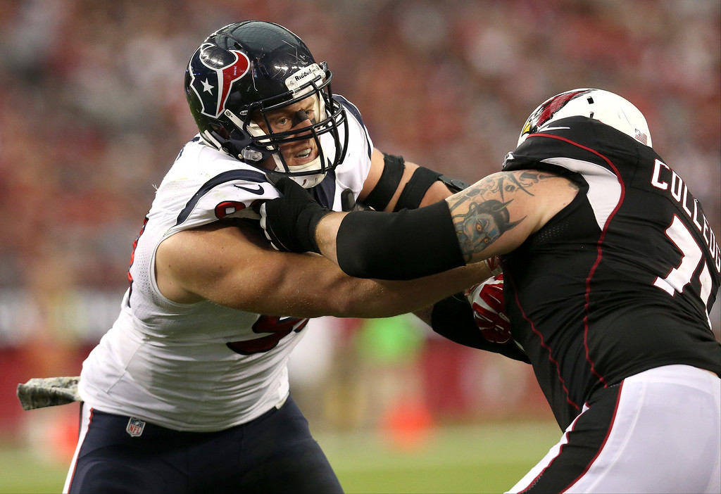 . Defensive end J.J. Watt #99 of the Houston Texans battles guard Dayrn Colledge #71 of the Arizona Cardinals at University of Phoenix Stadium on November 10, 2013 in Glendale, Arizona.  (Photo by Stephen Dunn/Getty Images)