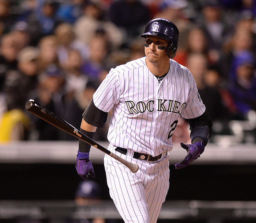 . DENVER, CO - MAY 15: Colorado batter Troy Tulowitzki flipped his bat after drawing a walk in the sixth inning. The Colorado Rockies hosted the San Diego Padres at Coors Field  Friday night, May 16, 2014. (Photo by Karl Gehring/The Denver Post)