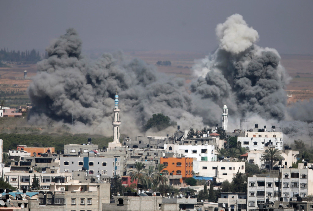 . Smoke rises after an Israeli strike in Gaza City, northern Gaza Strip, Thursday, July 31, 2014. (AP Photo/Majed Hamdan)