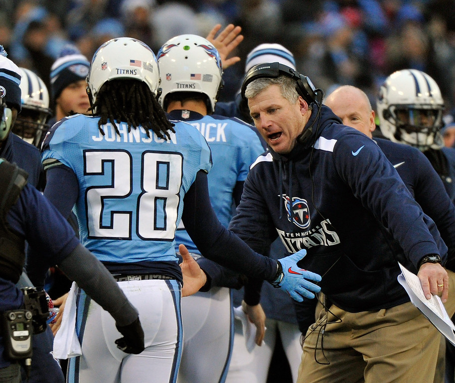 Description of . Running back Chris Johnson #28 of the Tennessee Titans is congratulated by head coach Mike Munchak on scoring a touchdown against the Arizona Cardinals at LP Field on December 15, 2013 in Nashville, Tennessee.  (Photo by Frederick Breedon/Getty Images)