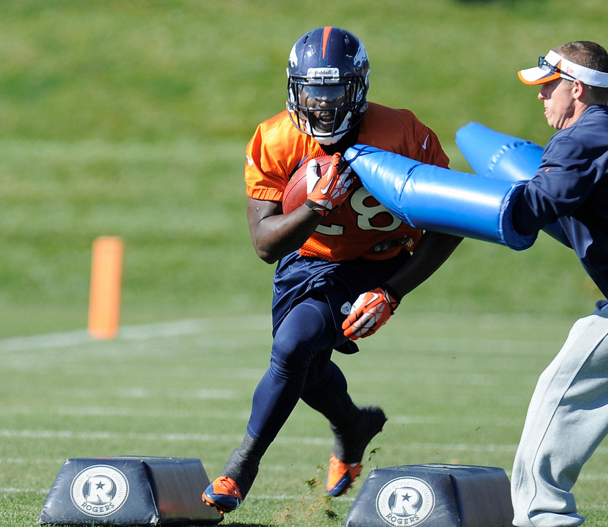 . Denver Broncos running back Montee Ball (28) runs through drills during practice on October 24, 2013 at Dove Valley. (Photo by John Leyba/The Denver Post)